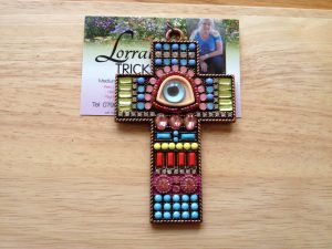 Beautiful beaded evil eye pendant / amulet