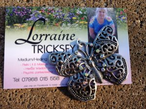 Lovely rainbow beaded butterfly pendant